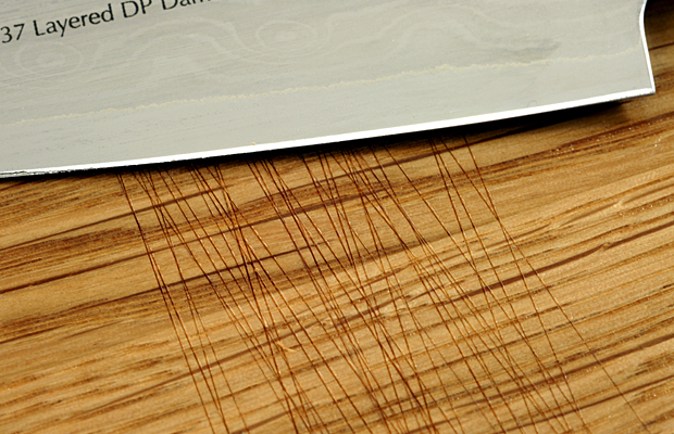 Image 1. Cuts at an oak face grain cutting board